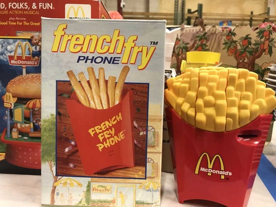 A McDonald's French fry phone is among the thousands of vintage McDonald's memorabilia pieces that will be auctioned Dec. 9, 2017, to benefit Ronald McDonald House Charities of Northwest Florida.