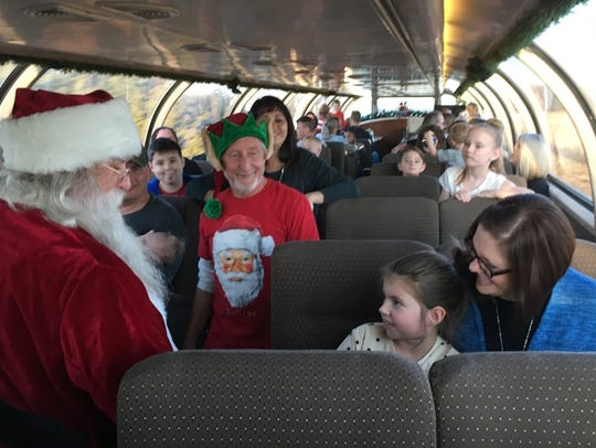 Eva Mudge, age 5, is a little leery of Santa as he