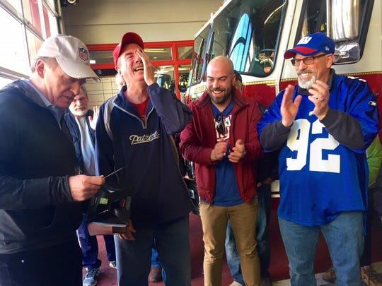 NFL Commissioner Roger Goodell, left, surprised Bill