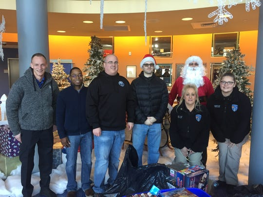 South River Police Department dispatchers held a toy