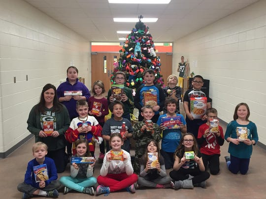 Mrs. Mangin's classroom at O.H. Schultz Elementary School was the top collecting classroom in this past December's food drive.