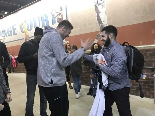 SDSU's Mike Daum greets former teammate Michael Orris