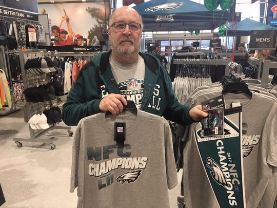 Mark Trachtman of Mount Laurel shops for Philadelphia Eagles gear at Dick's Sporting Goods in Moorestown on Monday, a day after the Eagles clipped the Vikings in the NFC title game.