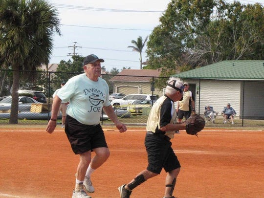 Lee Dilk streaks down the first base line, beating the attempt of put out by the Moose Lodge's Jerry Kratz.