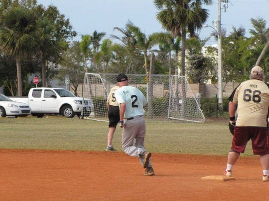 Doreen's Bob Grimm is running second heading towards home on a homerun he belted against the Moose Lodge.