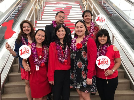 "Senators and Macy's employees support a resolution in recognition of the month of February as ""Go Red for Women Month"" at Macy's in the Micronesian Mall on Feb. 3."