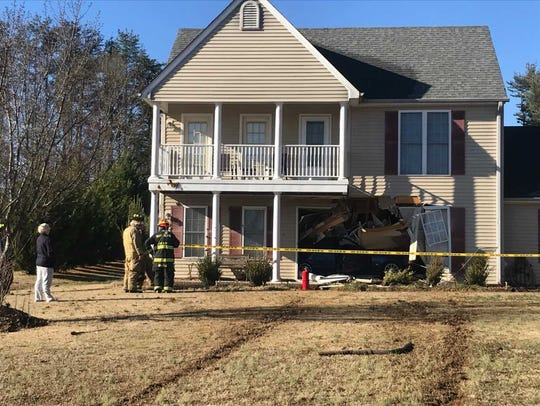 A car slammed into a house Monday morning near Pelzer.