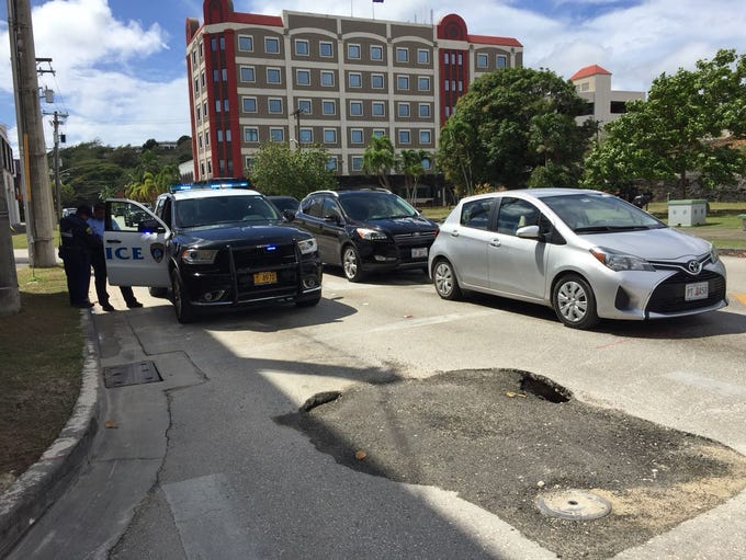 Guam Police Department vehicle blocks a lane where