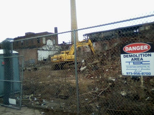 Paterson Mayor Andre Sayegh originally eyed an August auction for the former Leader Dye property, but recently decided it would be best to wait until the extent of chemical contamination at the site can be determined. The older factory was demolished in February.
