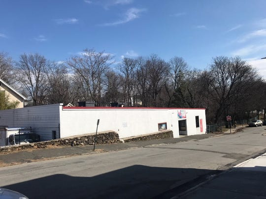 An abandoned warehouse on Phillips Park Road in Mamaroneck. A developer wants to knock the building down and construct five town homes in its place.