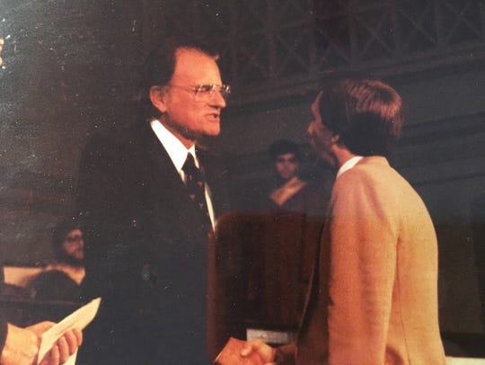 Jerry Drace shakes hands with Rev. Billy Graham in