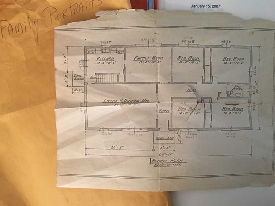 Helen Harney drew the floor plan for the family home she and her husband helped build.