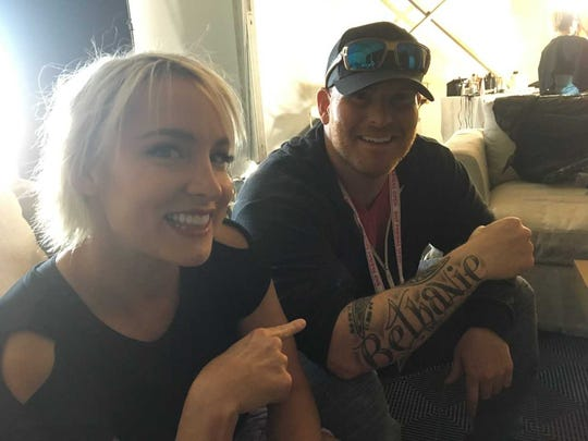 Bethanie Mattek-Sands, a US pro tennis player ranked 26 in doubles, points to her husband Justin's tattoo of her name. (March 3, 2018)