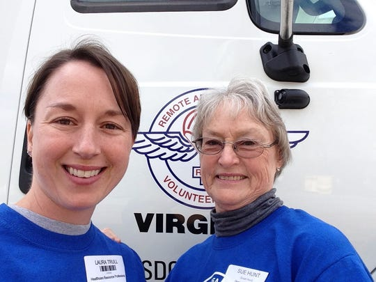 JMU Professor Laura Hunt Trull stands with her mom Susan Hunt in front of a Remote Area Medical of Virginia truck. Both volunteer at RAMs throughout the state. In 2019, Trull will be the lead clinic organizer for a RAM clinic coming to Harrisonburg.