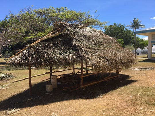 Huts are underconstruction at the University of Guam to prepare for its annual charter day.