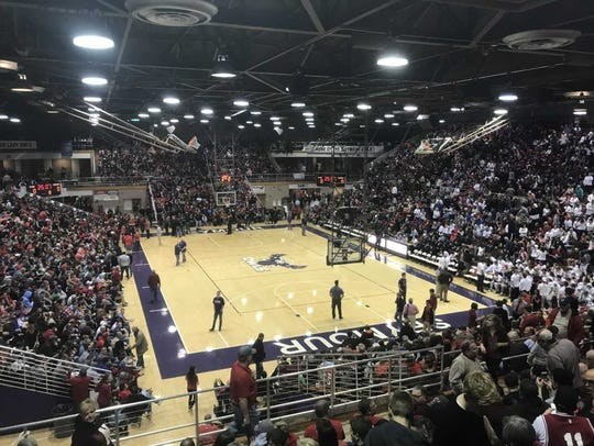 Over 8,000 fans filled Lloyd E. Scott Gymnasium in
