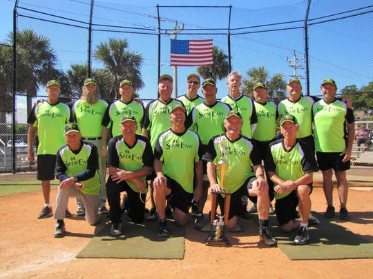 The Speakeasy Island Division Championship Team. Standing, left to right: Statistician Larry Anspach, Dan Marinelli, Jerry Engel, Bob Williams, Bob Grant, Tom Angelo, Michael Shone, Coach Rod Lashley, Tom Buettner and Bruce Chambers. Kneeling, left to right: John Remhoff, Andre Paquette, Dave Johnson, Manager Ray Kane and Mike Puskar.