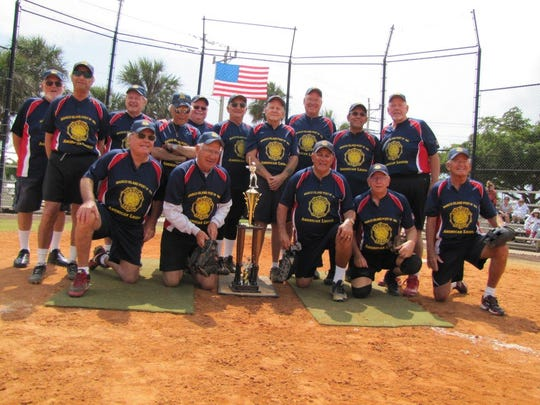 American Legion Post 404 Gulf Coast Division Championship Team. Standing, left to right: Manager Pat Reese, Al Bozzo, Ron Burger, Coach Dom Fiorda, Coach Jim Conway, Bill Dauch, Dan Callahan, Mick Keller, Charles Pineno and Gregg Graycarek. Kneeling, left to right: John Gill, Steve Slaggie, Rick Condle, Alan Schneider and Dave Banghart.