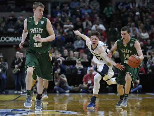 Forest Park' Daniel Lusk takes the ball up the court against Oak Hill in the Class 2A state championship game at Bankers Life Fieldhouse.