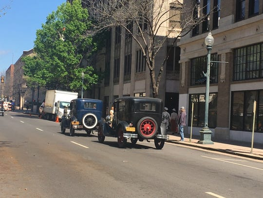 Period cars line Marshall Street in downtown Shreveport