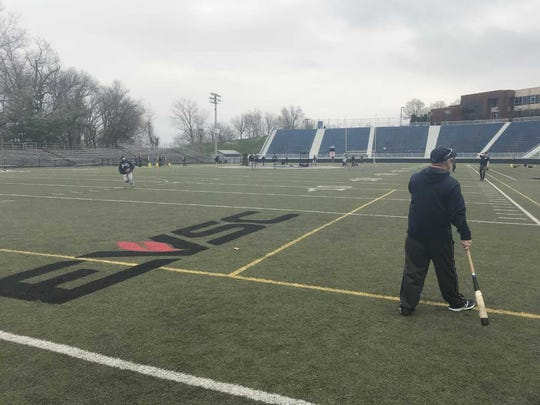 Reitz coach Todd DeWeese gives instructions to his team during a fielding drill. The Panthers needed to use the Reitz Bowl for practice because of the field conditions at Barker Complex.
