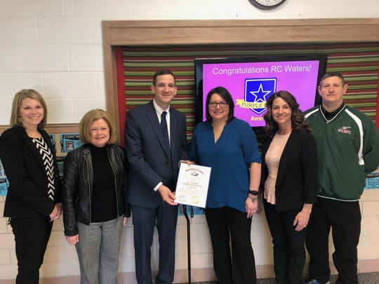 From left:, Assistant Principal Angie Lipstraw, northwest regional liaison LuAnne Cook, lieutenant governor liaison Jim Wasil, teacher Laurel Byington, Principal Dawn Bryant, and Superintendent Guy Parmigian.