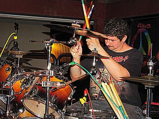 Mason Martin playing the drums with his band, Toxic.