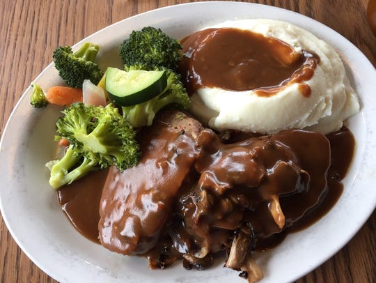 The savory meatloaf with mashed potatoes and gravy.