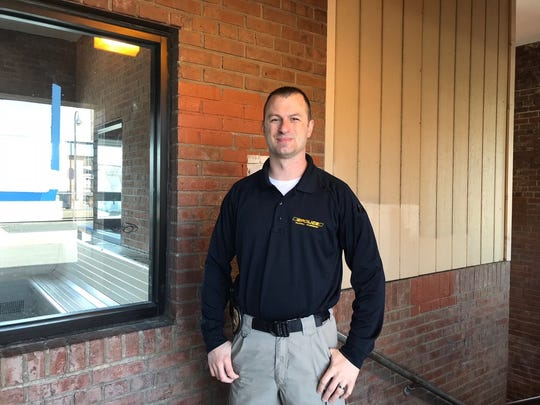 Clinton Detective Lawrence Anthes stands in the spot in the Dunellen Train Station where he arrested a man wanted in connection with a a Clinton Township home burglary.  Anthes and former Clinton Township Patrolman Matthew Murphy are being honored by the 200 Club of Hunterdon County for their actions in connection with the investigation.