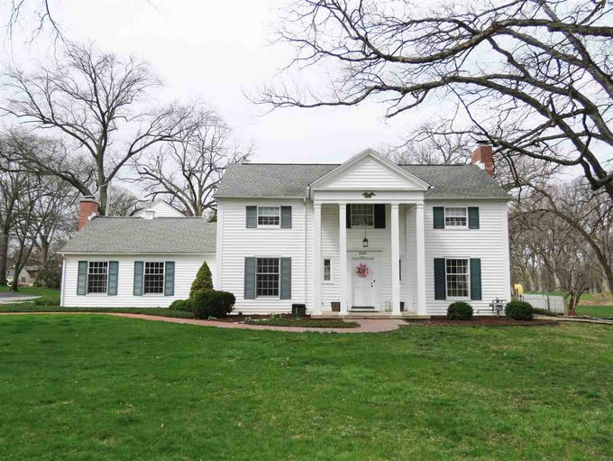 This 1940's Colonial in Lafayette overlooks the Lafayette
