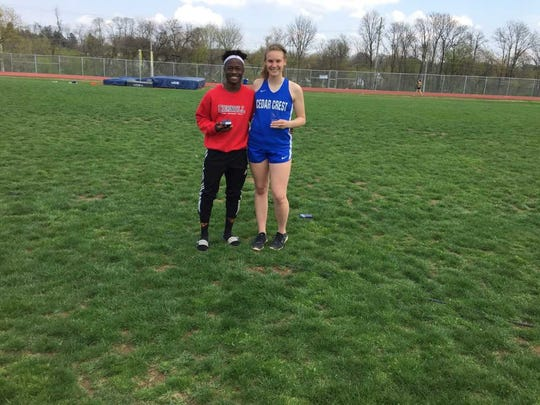 Annville-Cleona's Stanley Miller and Cedar Crest's Hannah Woelfling pose with their Outstanding Male and Female Athlete awards.
