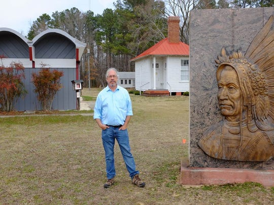 Pamunkey Chief Robert Gray on the reservation in King William County last month. Behind him are the tribe's museum, left, and its old schoolhouse, right. The tribe is working on plans for a $700 million casino in nearby New Kent County.