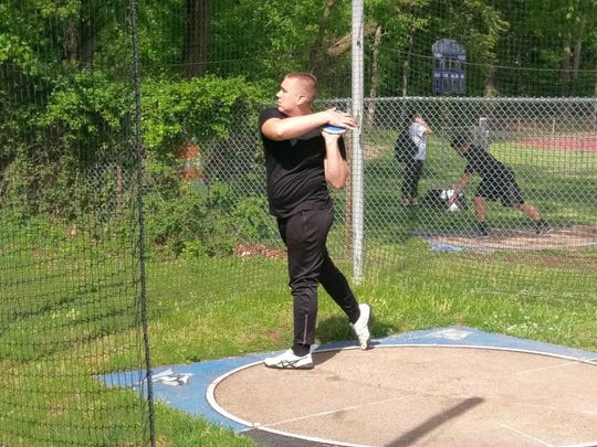 Middlesex's Matt Semon prepares to throw the discus
