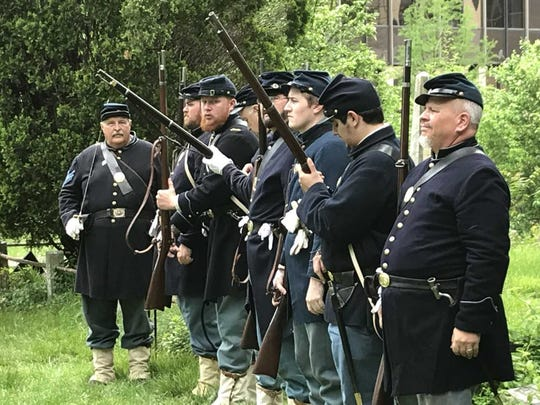 The Second New Jersey Brigade, 7th Regiment New Jersey Volunteers, fired rifles to honor Civil War Private Heyward Glover Emmell during his grave re-dedication ceremony on May 20, 2018, in the Presbyterian Church of Morristown.