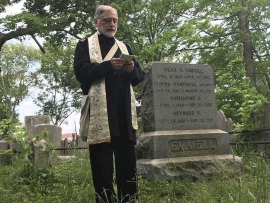 Father David Moreno, chaplain of the Second New Jersey Brigade, gives a speech about Civil War Private Heyward Glover Emmell during Emmell's grave re-dedication ceremony in the graveyard behind the Presbyterian Church of Morristown on May 20, 2018.