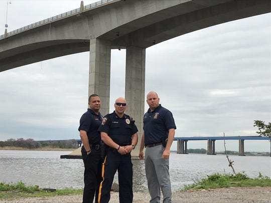 Perth Amboy Detective Crescencio Fuentes, Officer Danny Gonzalez and Detective Luis Perez stand under the Victory Bridge where they rescued a man threatening t jump last year.
