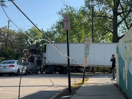 Truck takes down utility lines on Maxwell Street on