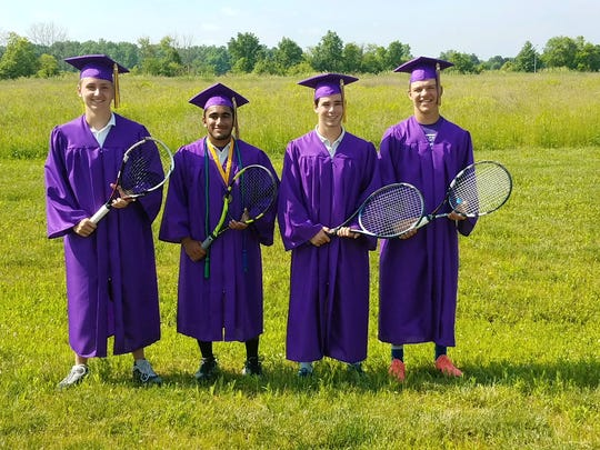 Lexington seniors Luke Webster, Ajit Venkatakrishnan, David Haring and Josh Mueller have some fun on graduation day in between matches of Sunday's Ohio Tennis Coaches Association state team tournament.