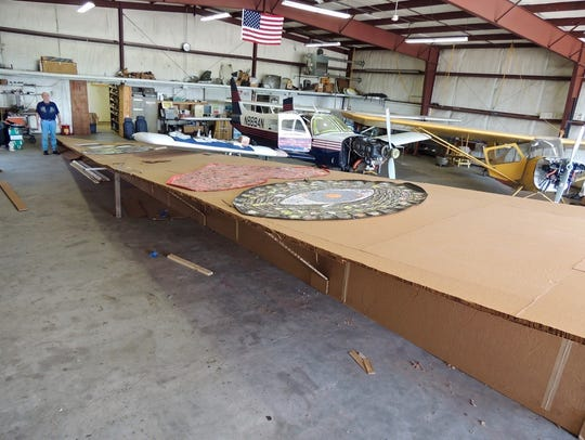 The 64-foot-long airplane piece is made of corrugated