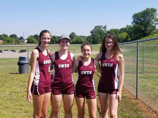 Laila Burk is at left with her Owen High 4x800 meter relay team at the regional meet. Other members from left are Lindsey Banks, Hannah Larios and Natasha Luchinina.