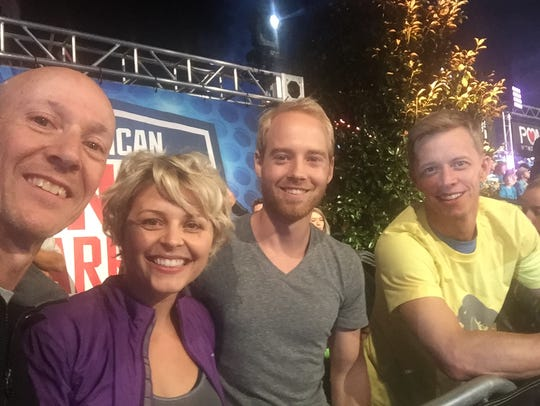 Bootie Cothran, Grace and Brett Sims pose for a selfie with Geoff Britten, one of only two American Ninja Warriors to win the grand prize.