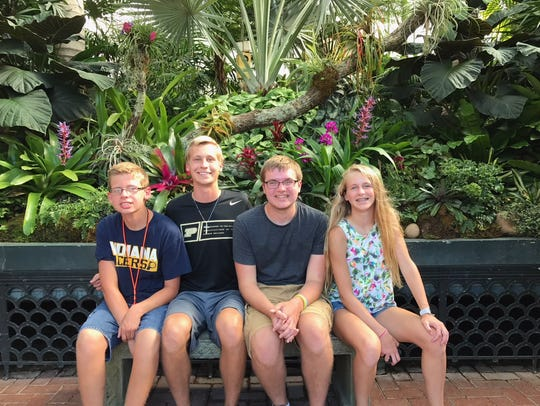 Ben, second from left, surrounded by siblings Caleb Disney, Will and Julia.