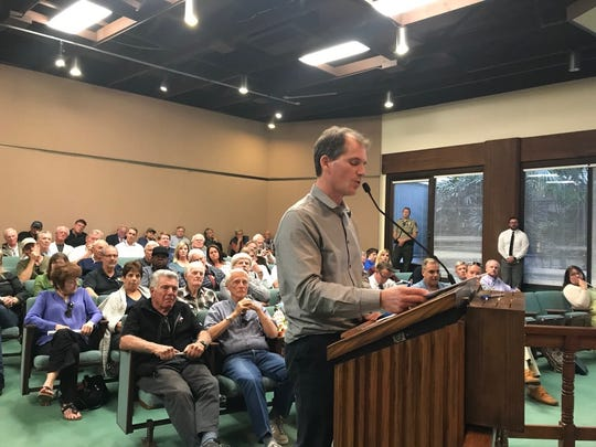 Joseph Lechman, an Agoura Hills resident who owns a hangar at the Camarillo Airport, talks at least week's meeting with airport officials about a plan for the airports to take over ownership of the hangars.