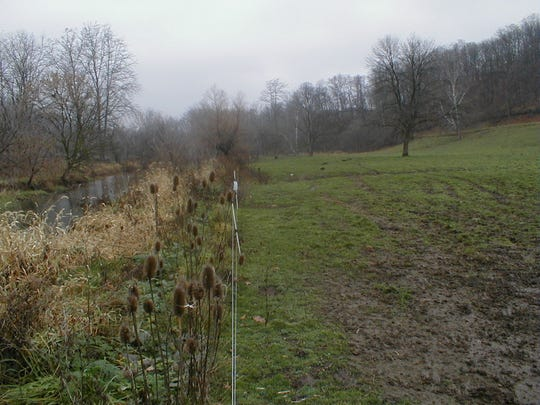 Fencing and plants along the right side of the Quittapahilla Creek protect it from pollution and runoff.