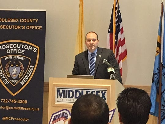 Middlesex County Prosecutor Andrew Carey at the podium