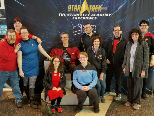 Members of USS Henry Hudson NCC are shown at Starfleet Academy Experience, Liberty Science Center, Jersey City, in March. Left to right, back row, are: Joseph Shields, Karen Tulchinsky, Sara Shields, Steven Robinson, Alex Hasapis, Debra Vecchiolla, Scott Garrity, Sara Vecchiolla and Lee Starshine. Seated, front, are Claire Vecchiolla and Krystina Mueller.