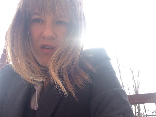 Carolyn Hank snapped an accidental selfie. She doesn't take selfies often but finds herself in selfies captured by other people.