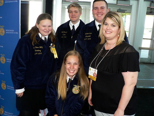 The Union Grove FFA officers and advisor, Carrie Jacob