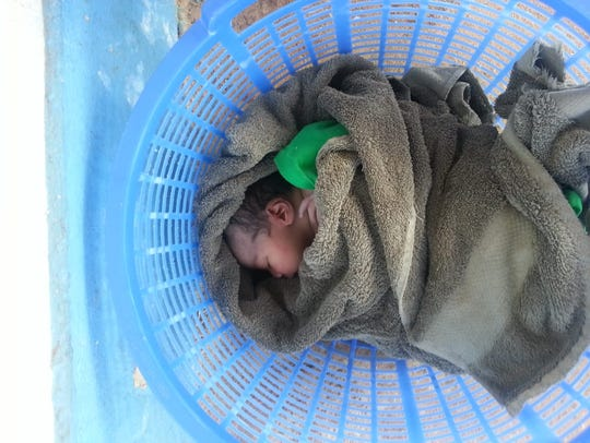 Photos of the baby dropped off at a Dededo home on