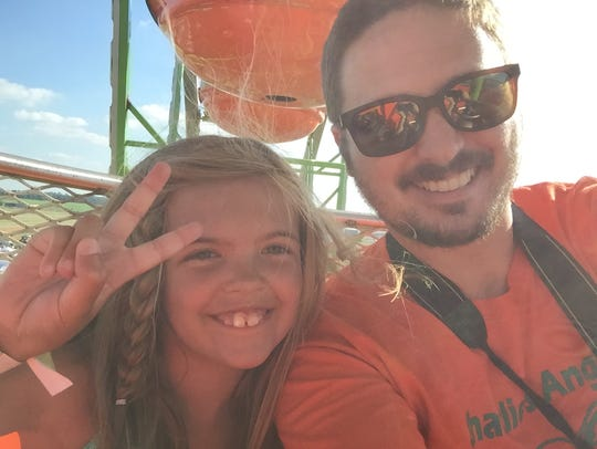 Charlie Buckley, 7, and her dad and Enquirer reporter